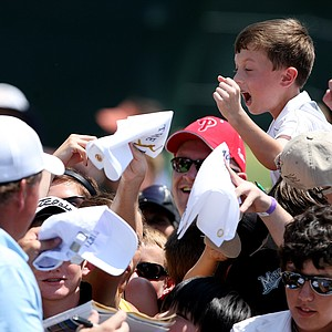Phil MIckelson signs autographs after his round on Saturday.