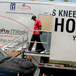 Tiger Woods leaves the fitness trailer en route to his SUV leaving the grounds after withdrawing from the final round due to a neck injury.