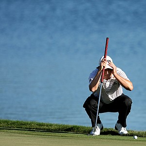 Tim Clark looks over his putt at No. 18 during the final round.