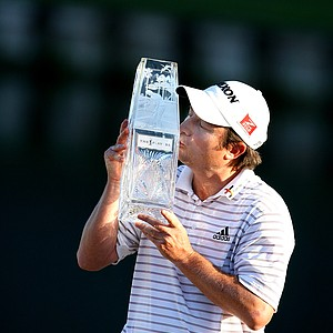 Tim Clark kisses the trophy after winning The Players Championship with a 16 under par, beating Robert Allenby by one stroke.