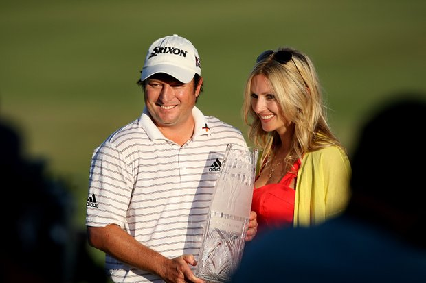 Tim Clark and his wife, Candie, pose after winning The Players Championship.