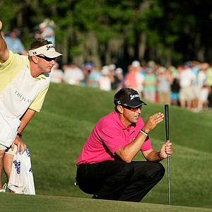 Robert Allenby and his caddie Colin Burwood read Allenby's putt at No. 18. Allenby needed to sink the putt to win.