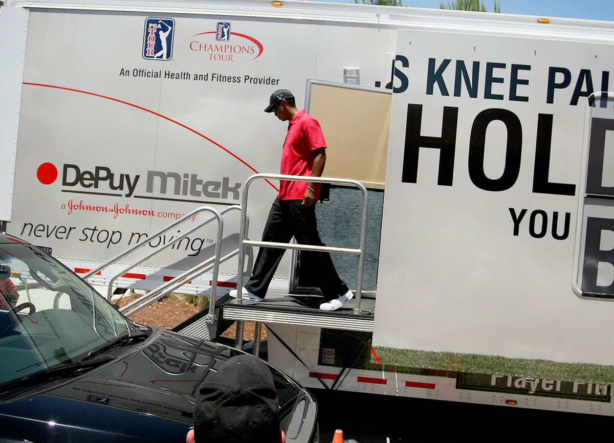 Tiger Woods leaves the fitness trailer en route to his SUV after withdrawing from The Players Championship on May 9.