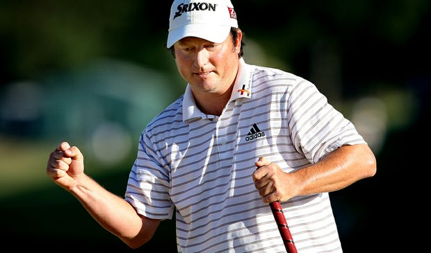 Tim Clark reacts after making a par putt on No. 18 at TPC Sawgrass on Sunday.