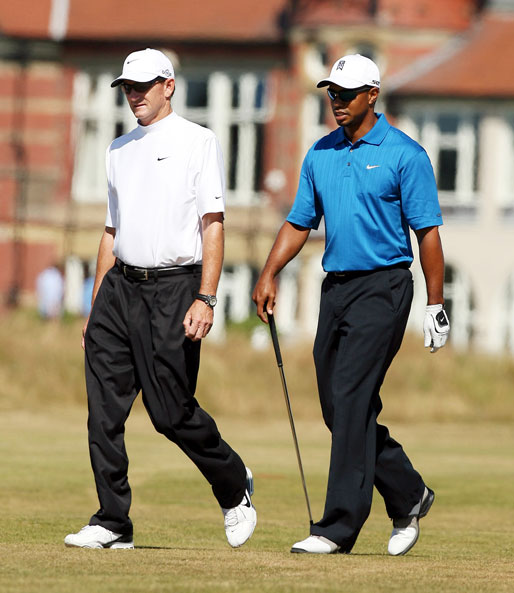 Tiger Woods walks with Hank Haney during a practice round at Royal Liverpool before the 2006 British Open.