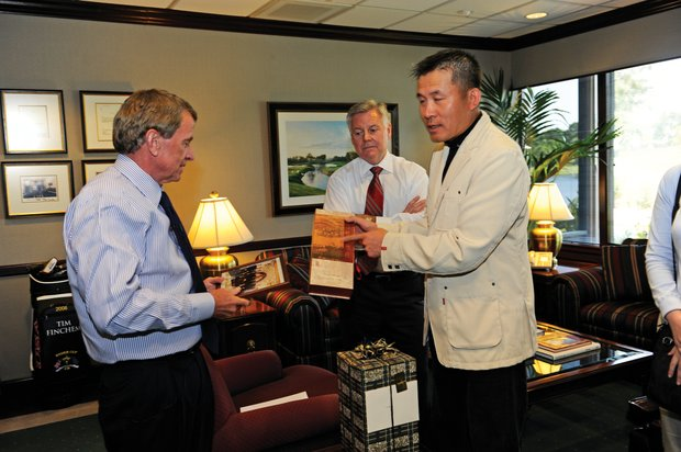 Pang Zheng meets with PGA Tour commissioner Tim Finchem (left) and co-chief operating officer Ed Moorhouse during a visit to Tour headquarters.