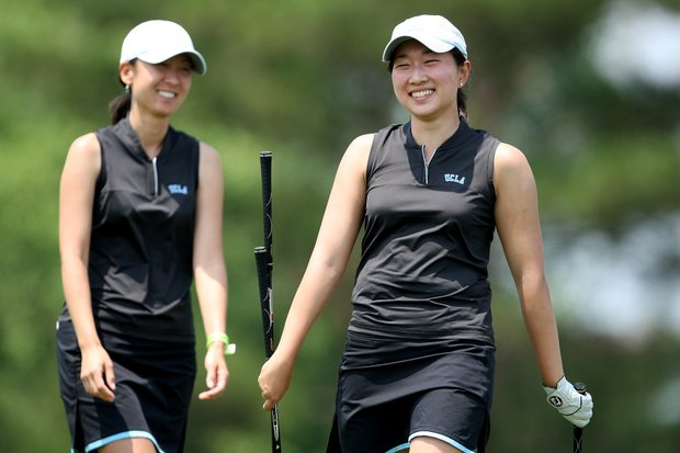 UCLA's Glory Yang celebrates with assistant coach Alicia Um after hitting to No. 2, an island like green during the second round.