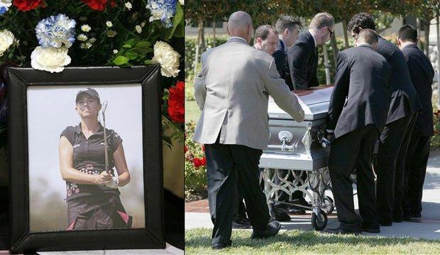 Pallbearers escort the casket of Erica Blasberg at a public memorial service at Eagle Glen Golf Club in Corona, Calif., Wednesday, May 19, 2010.