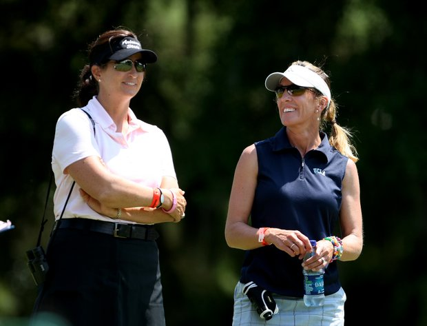 Arizona State head coach, Melissa Luellen, left, talks with UCLA head coach, Carrie Forsyth during the third round.