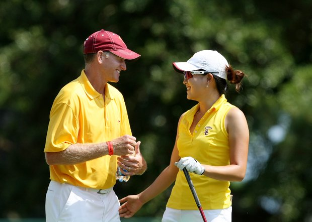 USC Director of Golf, Kurt Schuette, and Jennifer Song share a moment at No. 1 prior to the third round. Song will soon be turning pro.