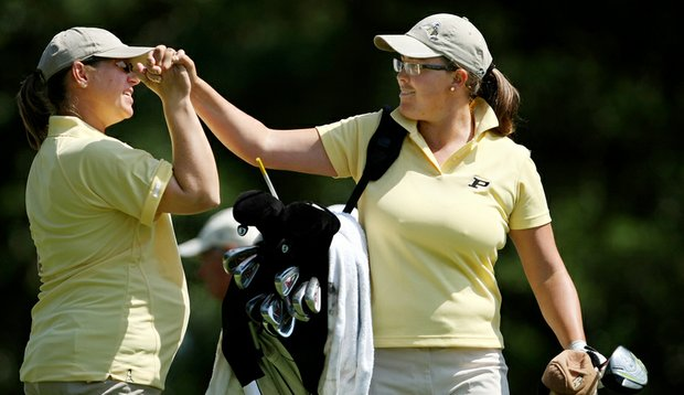Purdue assistant coach Johanna Joseffson sends Laura Gonzalez on her way at No. 1 during the third round of the Women's NCAA Championship at Country Club of Landfall.