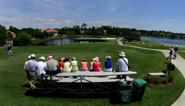 A crowd gathers at the bleachers at No. 2 to watch action at a couple of holes during the final round of the Women's NCAA Championship.