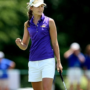 LSU's Megan McChrystal pumps her fist as she birdies No. 18. She shot a NCAA Championship record of 64.