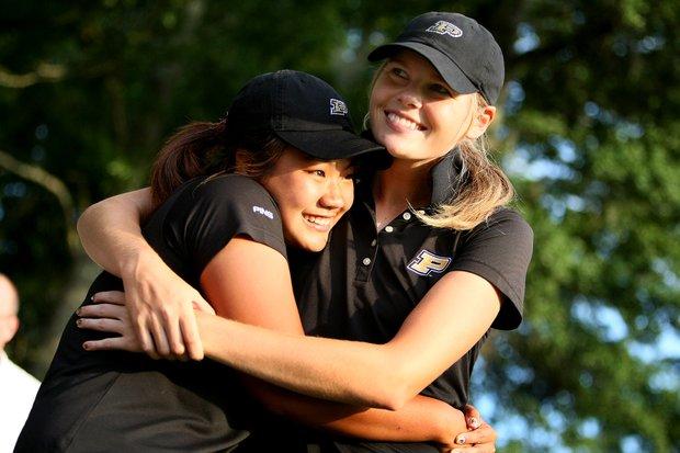 Purdue's Maude-Aimee LeBlanc and Numa Gulyanamitta celebrate winning the Women's NCAA Championship.
