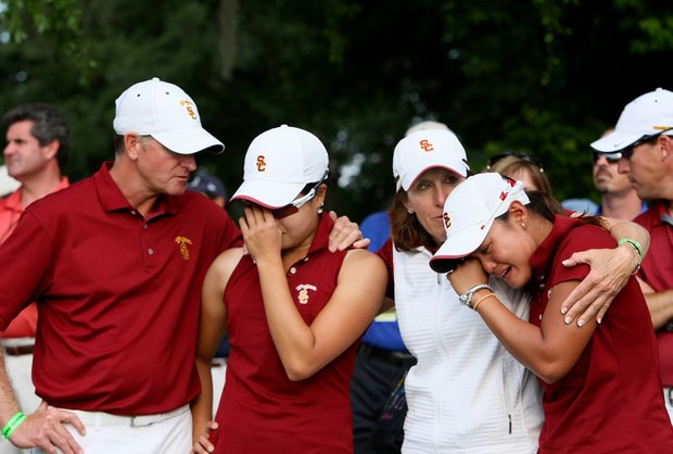 USC Director of Golf Kurt Schuette, and head coach, Andrea Gaston, console players Jennifer Song and Cyna Rodruguez.