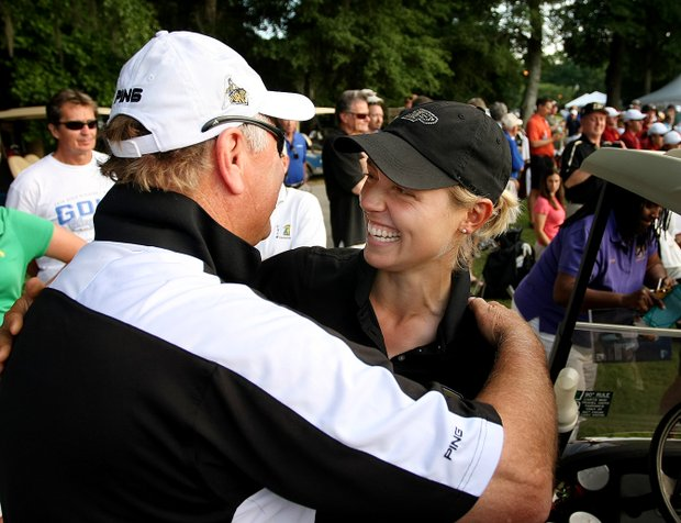 Purdue head coach Devon Brouse (left) hugs Thea Hoffmeister after winning the NCAA Women's Championship at the Country Club of Landfall.