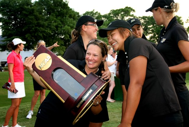 Purdue's assistant coach, Johanna Josefsson celebrates with the team after winning the Women's NCAA Championship.