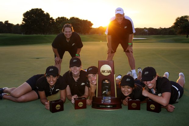 Purdue poses with the National Championship trophy at Country Club of Landfall.
