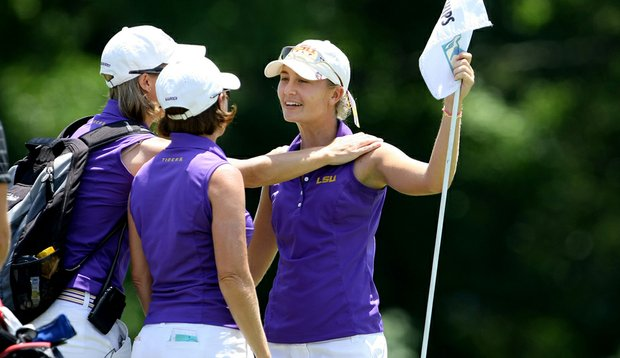 LSU's Megan McChrystal is greeted by Tigers head coach Karen Bahnsen and assistant Golda Johansson Borst.