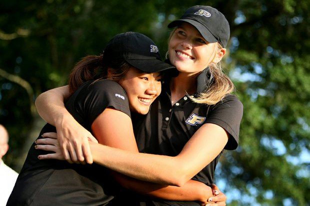 Purdue's Maude-Aimee LeBlanc (right) and Numa Gulyanamitta celebrate after winning the NCAA Women's Championship.