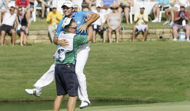 Jason Day of Australia leaps into the arms of his caddie Colin Swatton after winning the 2010 Byron Nelson Championship tournament.