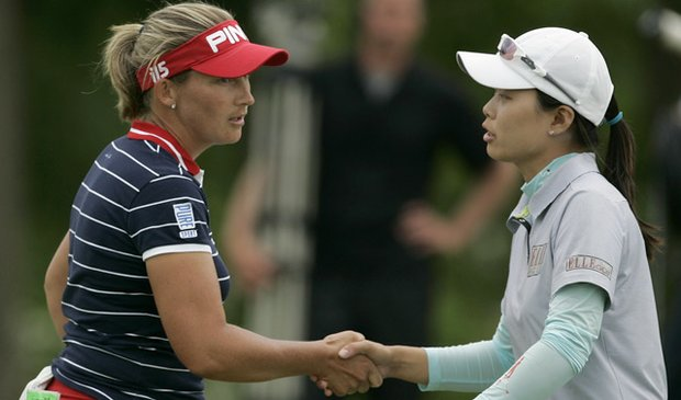 Angela Stanford, left, congratulates Sun Young Yoo of South Korea after Yoo's 3 and 1 victory on Sunday, May 23.
