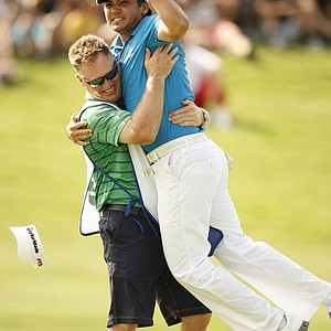 Jason Day leaps into the arms of his caddie Colin Swatton after winning the Byron Nelson Championship.