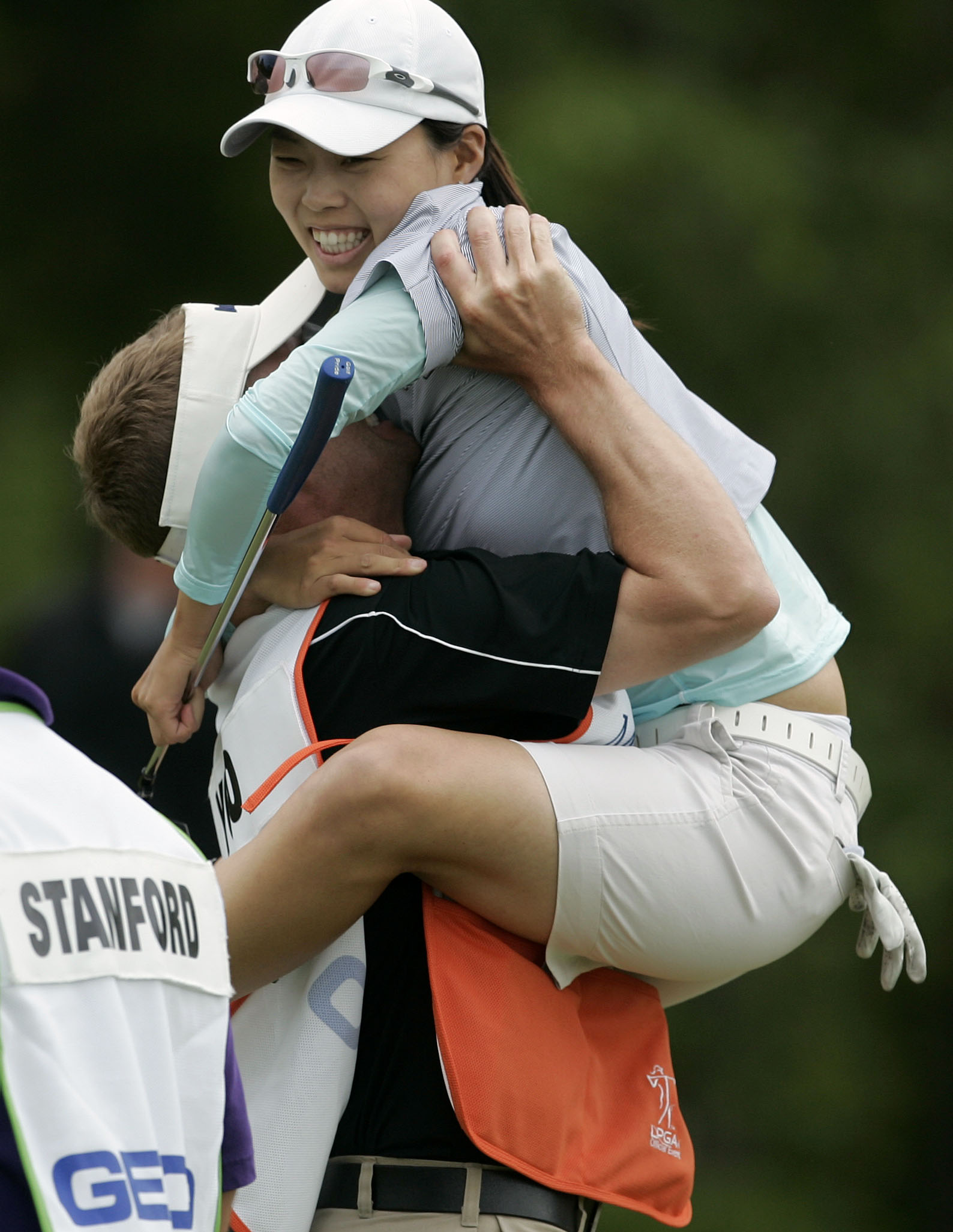 Sun Young Yoo jumps into the arms of her caddie, Kurt Kowaluk, after winning the Sybase Match Play Championship.
