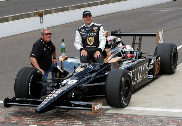 Fuzzy Zoeller (left) and driver Ed Carpenter.