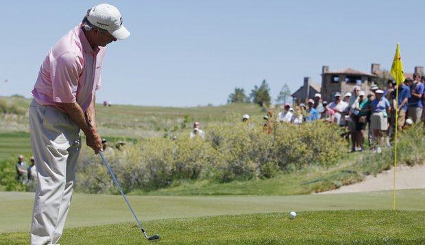 Fred Couples hits a chip shot at Colorado Golf Club during the 2010 Senior PGA Championship.