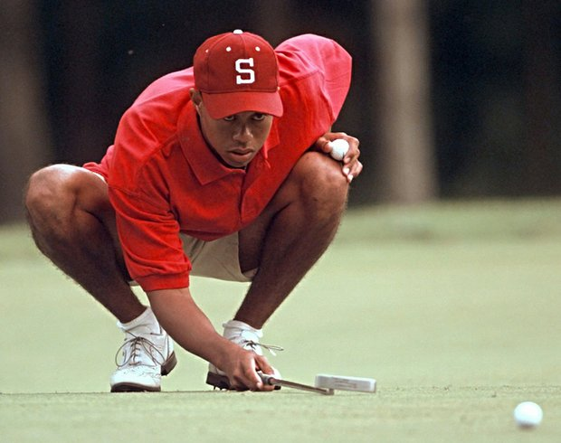 Tiger Woods studies at putt during the 1996 NCAA Championship.