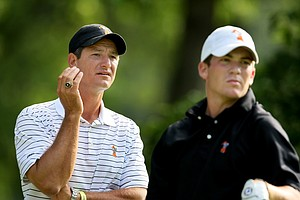 Oklahoma State's associate head coach, Alan Bratton watches Trent Whitekiller's tee shot at No. 10.