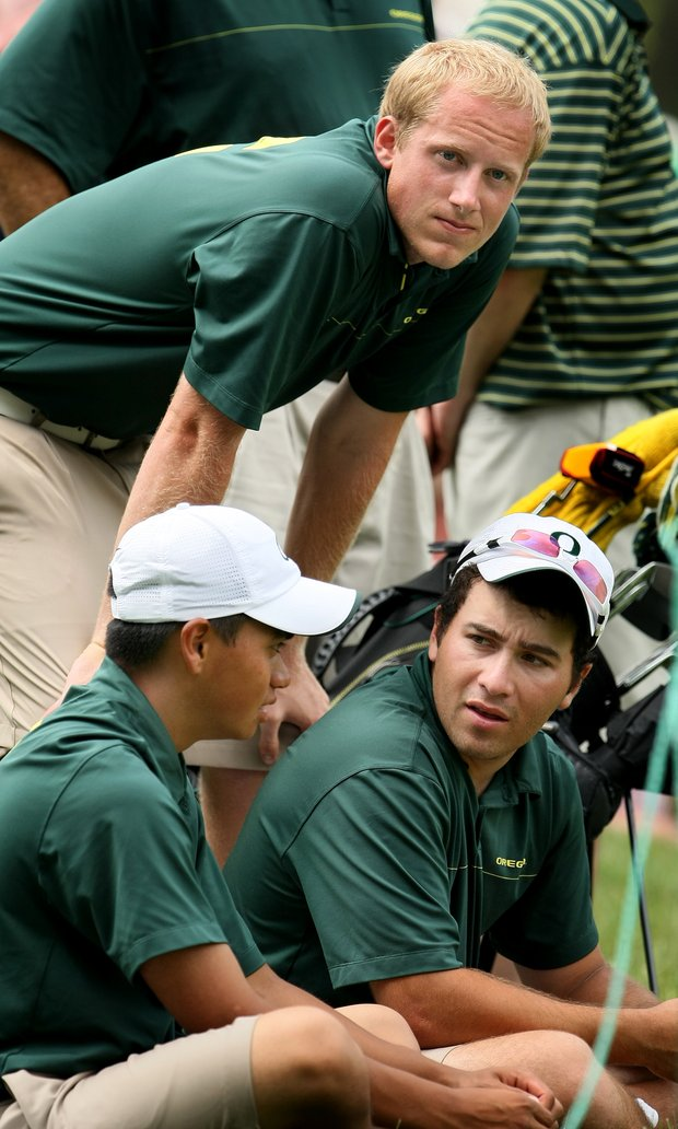 Oregon players, Jack Dukeminier(top), Isaiah Telles, left, and Andrew Vijarro, right, wait for their team to finish at the Honors Course during the second round.