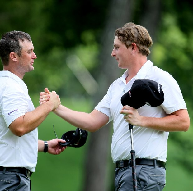 Augusta State head coach Josh Gregory, left, with Henrik Norlander after he tied for first at No. 18.