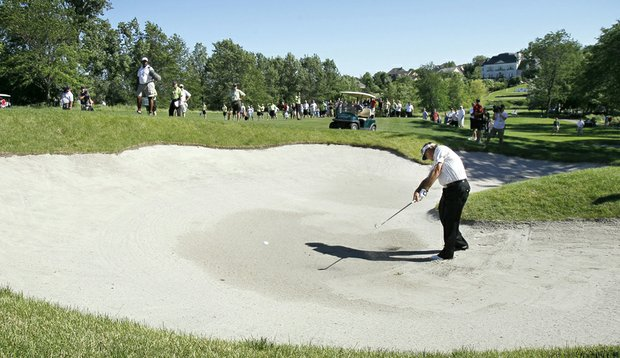 Tommy Armour hits out of a bunker at Glen Oaks Country Club during the Principal Charity Classic.