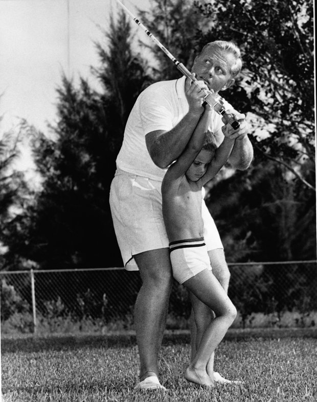 Jack Nicklaus and son, Gary, practice fishing.