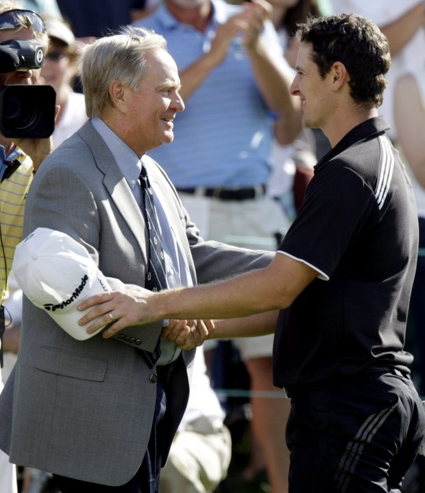 Jack Nicklaus congratulates Justin Rose after he won the 2010 Memorial.