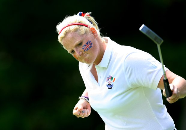 GB&I's Holly Clyburn of England pumps her fist after making her putt on No. 6.