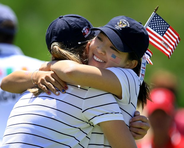 USA's Tiffany Lua of California hugs Cydney Clanton of North Carolina after Clanton halved her match during the morning foursomes.