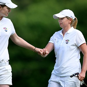 GB&I's Danielle McVeigh of Ireland, left, and Pamela Pretswell, right, of Scotland congratulate each other on Friday.