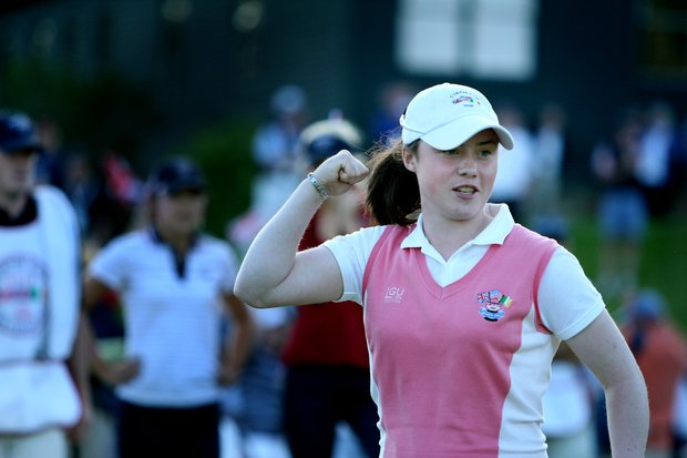 GB&I's Lisa Maguire of Ireland sinks her putt to halve No. 18 giving GB&I a full point lead over USA.