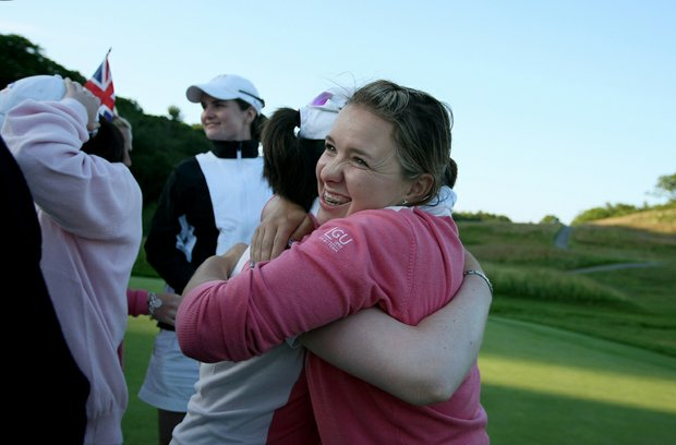 GB&I's Rachel Jennings hugs her partner after GB&I took the lead during afternoon four-ball matches at the Curtis Cup.