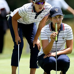 Jennifer Song, left, and Jennifer Johnson read a putt at No. 18 during morning foursomes at the Curtis Cup.