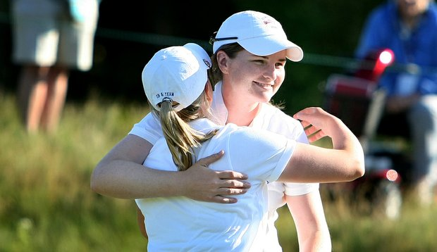 Great Britain and Ireland's Danielle McVeigh hugs her partner Pamela Pretswell after they won their match 4 and 3 Friday afternoon at the Curtis Cup.