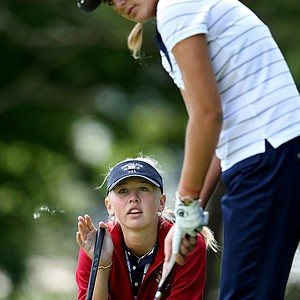 Jessica Korda helps Alexis Thompson read a putt at No. 6 during morning foursomes at Essex County Club.