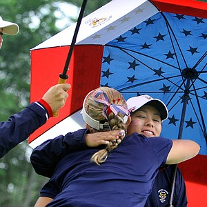 Team USA's Jessica Korda (left), Alexis Thompson and Stephanie Kono hug after the second point was clinched Saturday at the Curtis Cup.