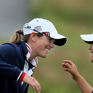 Cydney Clanton, left, and Stephanie Kono celebrate after four-ball matches during Day 2 of the Curtis Cup.