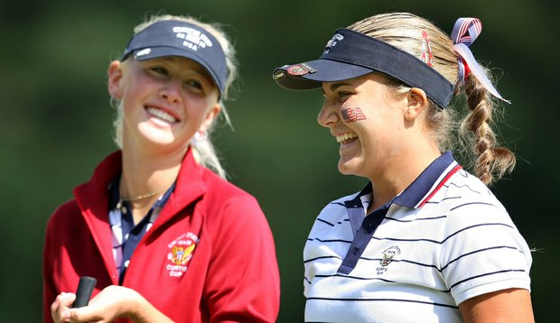 Jessica Korda and Alexis Thompson share a laugh during Friday morning's foursomes.