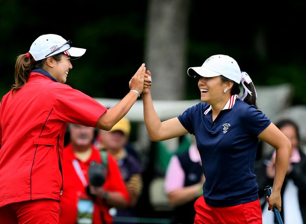 Kimberly Kim, right, and Stephanie Kono celebrate Kono's point at No. 17. The pair won their match over Sally Watson and Rachel Jennings.