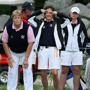 GB&I captain Mary McKenna, left, manager Tegwen Matthews and player Pamela Pretswell react to a putt at No. 17. Pretswell and partner Danielle McVeigh lost to Alexis Thompson and Jessica Korda in morning four-balls on Day 2.